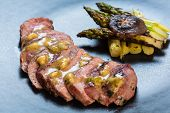 picture of duck breast  - Duck breast on orange sauce with vegetable - JPG