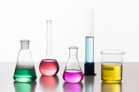 picture of chemical reaction  - Glass in a chemical laboratory filled with colored liquid during the reaction  - JPG