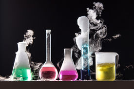 image of chemical reaction  - Glass in a chemical laboratory filled with colored liquid during the reaction  - JPG