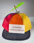 pic of enterprise  - Colorful hat with green propeller with sign that says - JPG