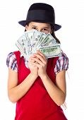 picture of money prize  - Dreaming girl in black hat hide face in money in hands - JPG