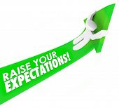 foto of greater  - Raise Your Expectations words on a green arrow ridden by a man or person aiming higher in work - JPG