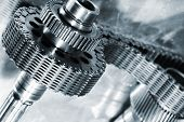 stock photo of titanium  - titanium and steel cogs powered by large timing - JPG