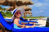 image of beach hat  - cute little girl in big hat on summer tropical beach  - JPG