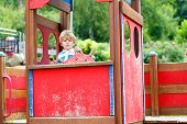 pic of imaginary  - Cute child boy pretends driving an imaginary car on kids playground outdoors. On warm summer day. ** Note: Visible grain at 100%, best at smaller sizes - JPG