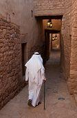 stock photo of saudi arabia  - Saudian walking inside the walls of Al - JPG