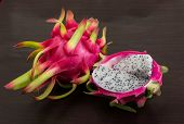 image of dragon fruit  - Asian Dragon fruit on the wooden background - JPG