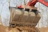 picture of wheel loader  - A tilt wheel excavator with a shovel earth on a mountain  - JPG