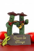 stock photo of cactus  - Happy Cinco de Mayo concept with fun Mariachi Band Cactus players and greeting card on red wood table - JPG