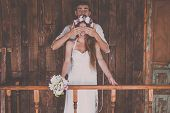 image of marriage decoration  - Young and beautiful bride and groom are having a good time - JPG