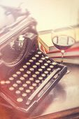 pic of writing  - Old vintage typewriter with glass of wine pencils and books in this retro creative writing and relazation themed desk top - JPG