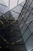foto of deformed  - Glass walls of modern skyscrapers viewed and deformed by a glass ceiling - JPG