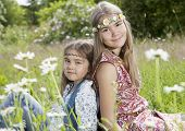 stock photo of hippy  - Beautiful romantic girls sitting in the field - JPG