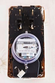 pic of electricity meter  - electricity supply meter on wall of room in country house - JPG