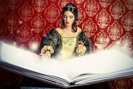 pic of fairies  - Fairy beautiful witch reads magic book of spells - JPG