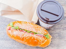 foto of bag-of-dog-food  - Take away cup of coffee and hot dog with paper bag - JPG