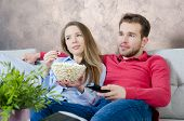 Couple Enjoys Free Time And Watching Tv poster