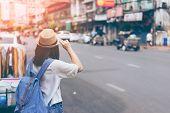 Young Woman Traveler Looking The Way In Bangkok China Town poster