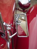stock photo of mg  - reflection in mirror of veteran sports car - JPG