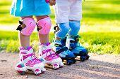 Kids Roller Skating In Summer Park poster