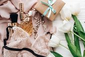 Stylish Craft Present Box And Lace Lingerie Jewelry And Perfume Present On Soft Fabric And Tulips On poster