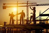 stock photo of construction crane  - Work on the construction at night - JPG