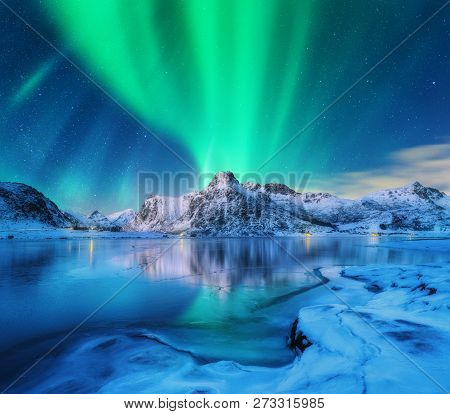 Aurora Borealis Over Snowy Mountains