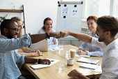 Guys Fist Bumping Congratulating Each Other With Success At Work poster