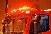 Red Lights Of A Fire Engine. Night Time. Fire Engine. Extinguishing The Fire. Close-up Of The Red Li poster