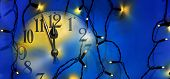 Clock Face And Christmas Electric Light Before Midnight poster