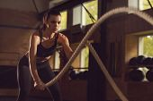Fit, Sporty And Athletic Sportswoman Working In A Gym. Woman Training Using Battle Ropes. Sports, At poster