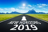 A road to horizon with text new horizons 2019 poster
