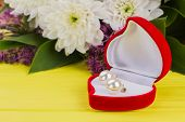 Heart-shaped Box With Earring And Flowers. Valentines Day Background With Pearl Earrings In Velvet B poster