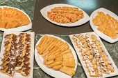 Various Desserts In The Restaurant. Composition Of Pastry Desserts Of Various Flavors, Flavors And C poster