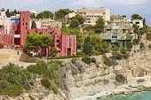 Spanish Mediterranean Coastline In Alicante, Calpe. Buildings Landmarks. Tourism poster