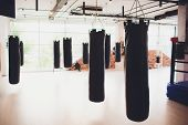 Black Punching Bag For Boxing Or Kick Boxing Sport. poster