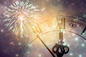 New Years at midnight - Old clock with fireworks and holiday lights poster
