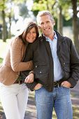 picture of portrait middle-aged man  - Portrait Of Romantic Couple Enjoying Outdoor Walk Through Autumn Park - JPG