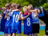 Kids Sports Team. Group Of Soccer Team Players Standing Together With Coach. Coach Giving Young Spor poster