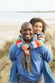 pic of family vacations  - Black Family on a beach - JPG