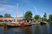 stock photo of flatboat  - Restaurant at canal and traditional Dutch flat boats  - JPG