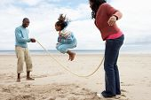 pic of skipping rope  - Family playing on beach - JPG