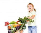 foto of grocery-shopping  - Happy healthy little girl with vegetables in shopping cart  - JPG