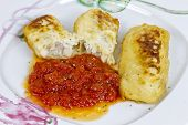 picture of hake  - hake fillet with fresh tomato sauce freshly cooked - JPG