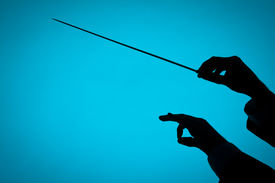 image of nonverbal  - Male orchestra conductor hands one with baton - JPG