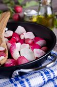 pic of vedic  - sliced ??radishes lying in a baking dish ** Note: Shallow depth of field - JPG