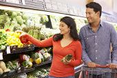 image of supermarket  - Couple shopping in supermarket - JPG