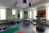 stock photo of training room  - Spacious empty room with special equipment for physical training - JPG