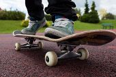 picture of skate board  - Young person rides on skateboard on court - JPG
