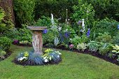 pic of garden sculpture  - Bird bath in a beautiful summer garden - JPG